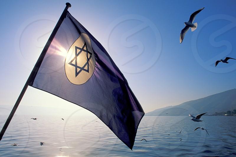 Israeli Flag on the Sea of Galilee Israel.  photo