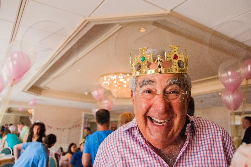 man wearing gold crown at the party photo