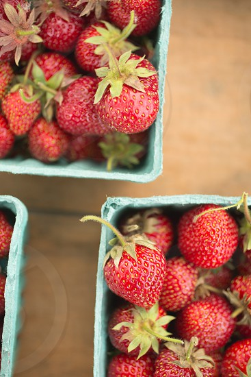 red strawberries in blue square container photo