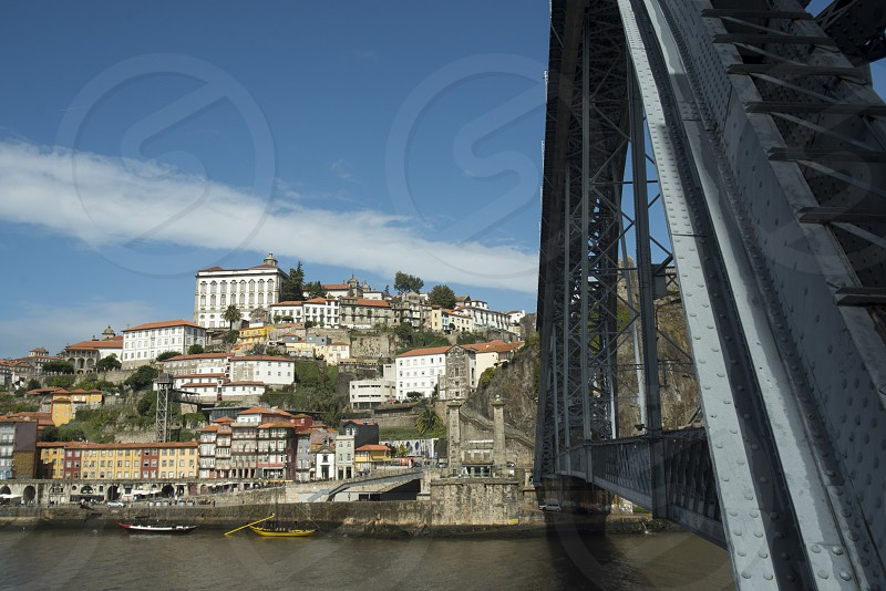 the Ponte de Dom Luis 1 at the old town on the Douro River in Ribeira in the city centre of Porto in Porugal in Europe. photo