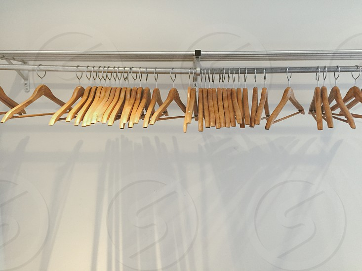 Closet wood hangers white walls photo
