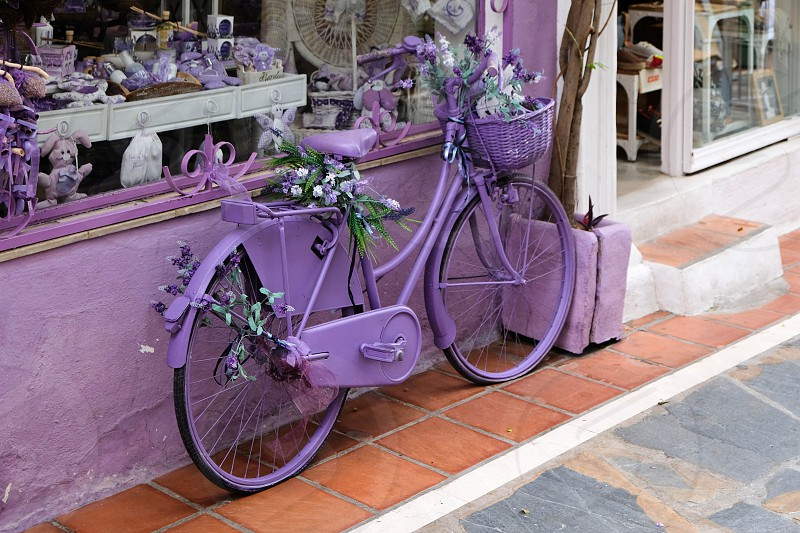 Lavender Bicycle outside a Shop  in Marbella photo
