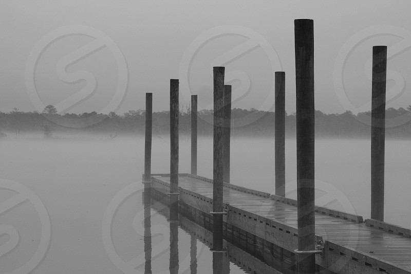 Fog at dusk on the Neuse River in New Bern North Carolina. photo