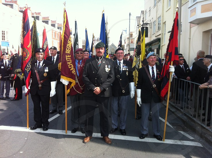 Army veterans ready to march on parade at the 70 years anniversary of d day on the very where 700000 troops left during the biggest invasion in world history  photo