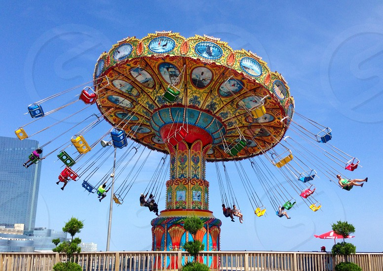 people riding in carnival rides photo