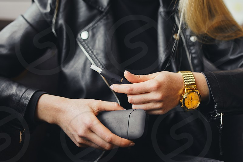 Close up electronic cigarette with case and blur girl on background photo