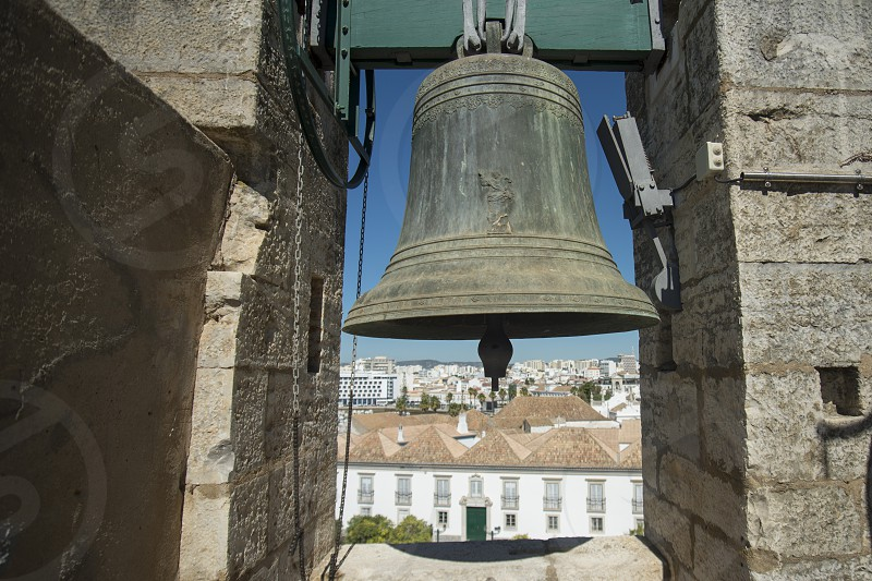 the clock tower of the Cathedral in the old town of Faro at the east Algarve in the south of Portugal in Europe. photo