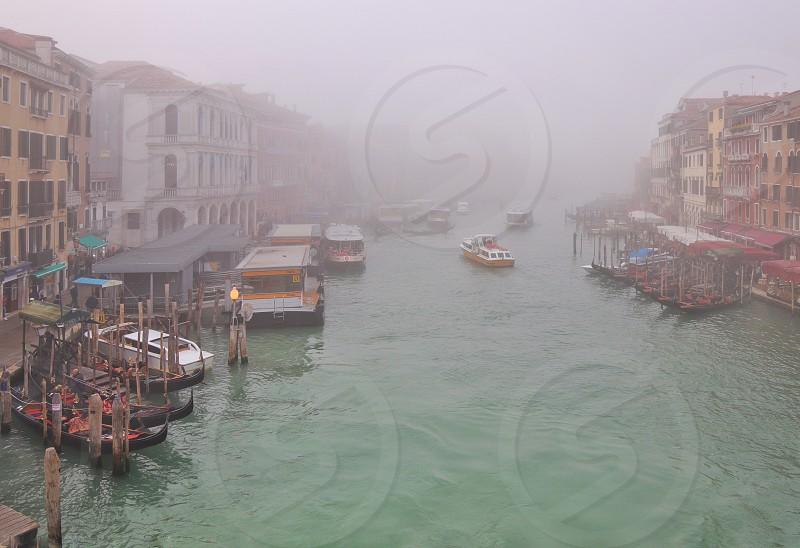 Italy Venice canals boat gondola fog river  photo