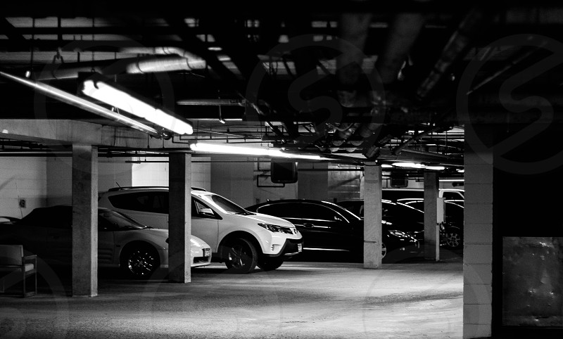Line of cars in a parking garage photo