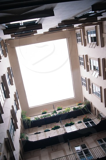 Looking upward from a central courtyard inside an apartment complex in European city photo