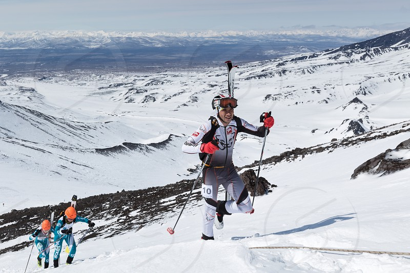 "AVACHA VOLCANO KAMCHATKA RUSSIA - APRIL 26 2014: Individual race. Ski mountaineering Asian Championships Ski mountaineering Russian Championship International competitions ISMF series ""Kamchatka Race"" Ski mountaineering Kamchatka Championship. photo"