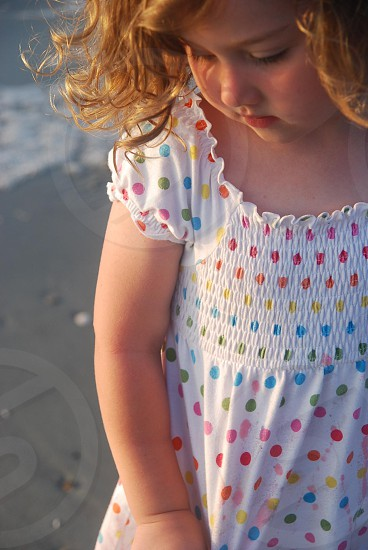 selective focus photo of a girl wearing white dress photo