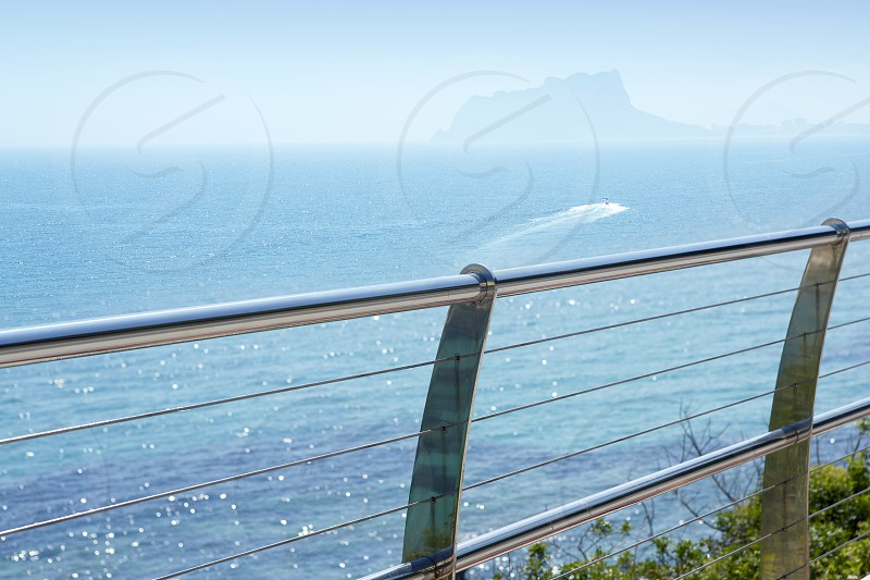 stainless steel balcony banister to mediterranean sea in moraira alicante spain photo