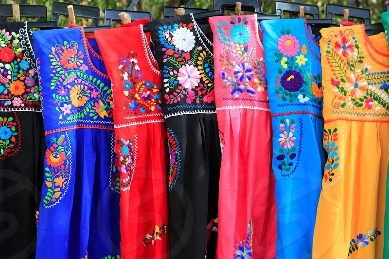 Mayan woman dress flowers embroidery Yucatan Mexico photo