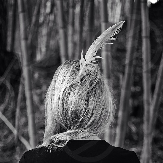 person with feather in hair photo