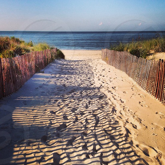 view of beach sand and brown fences photo