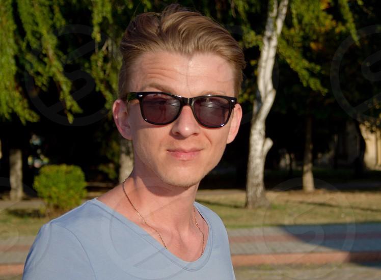 Man millennial adult portrait summertime sunglasses outdoor smiley face handsome photo