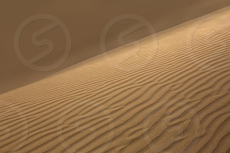 Desert sand dunes in Maspalomas Gran Canaria at Canary islands photo