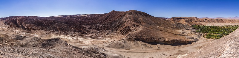 A panoramic view over the Atacama Desert valleys where some oasis can be found Chile  photo
