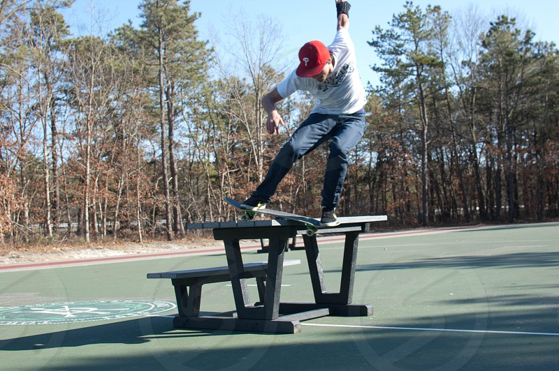 man doing skateboard trick photo
