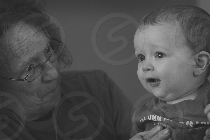 woman holding toddler photo