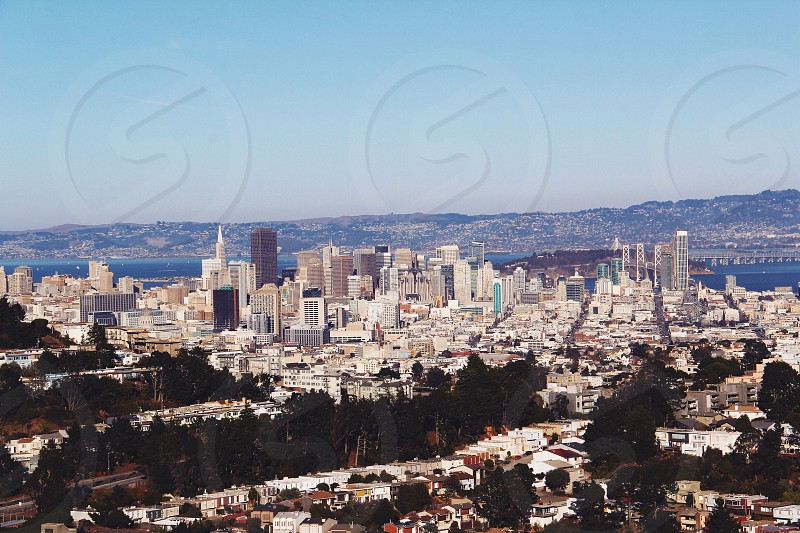 city scape by the ocean and mountains  photo