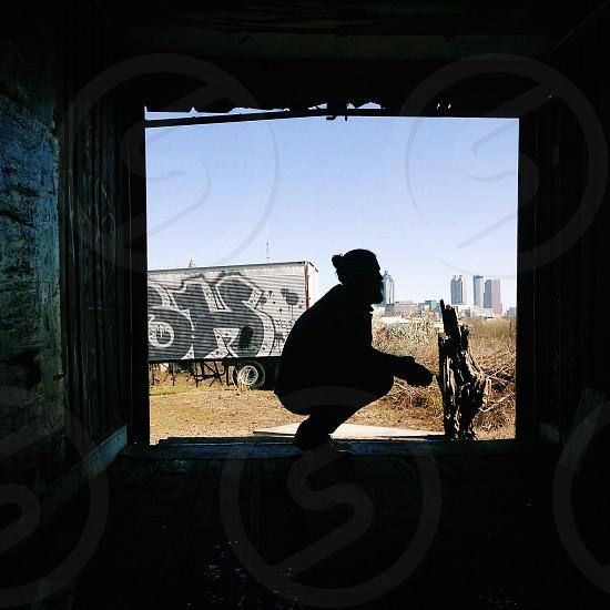 man sitting silhouette photo