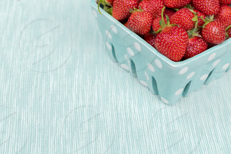 A basket of freshly picked strawberries photo