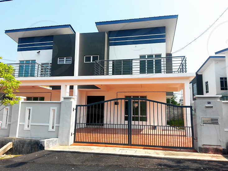 blue white 2 story stucco building photo