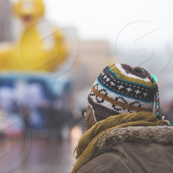 A woman wearing a fun hat watching a Thanksgiving/Christmas parade in Grand Rapids Michigan. photo