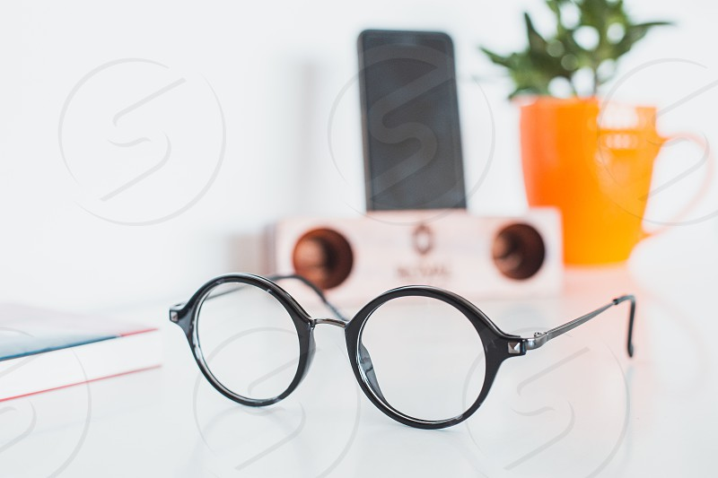 Glasses with phone and plant photo