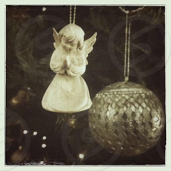 Angel ornament on a christmas tree photo