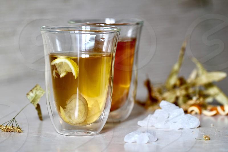 Tea green tea drink lemon linden tea shine glass cup of tea fresh relax sugar healthy food and drink delicious photo