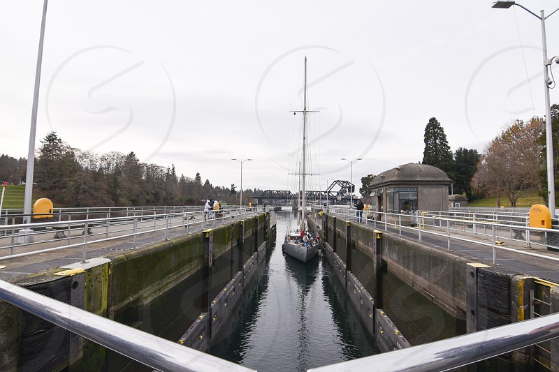 Boat docking at Ballard Locks crossing from the Puget Sound into Lake Union photo