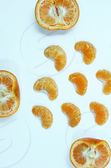 Isolated orange Collection of whole orange or clementine fruits and peeled segments isolated on white background with clipping path - Image photo