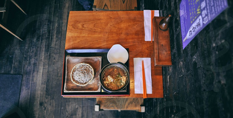 aerial photography of soup in a bowl on a tray with noodles photo
