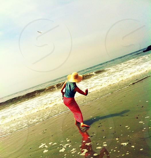 woman throwing stone photo