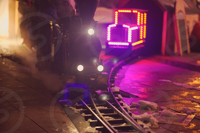 Miniature Steam Locomotive Attraction at Night Front View photo