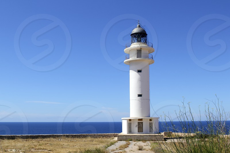 Barbaria lighthouse formentera Balearic islands blue sunny mediterranean day photo
