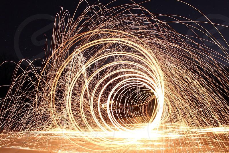 orange spiral fireworks under night sky photo