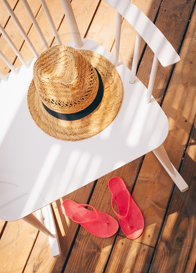 Summer accessories on wooden chair and floor. Top view and copy space photo