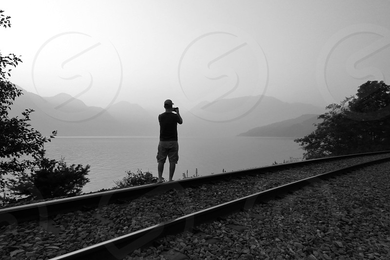 Documenting the mountain smoke from British Columbia fires the silhouette of a photographer capturing the shot. photo