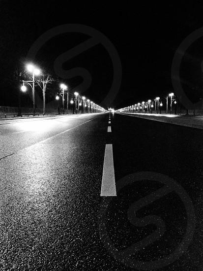 gray pavement with street lights photo