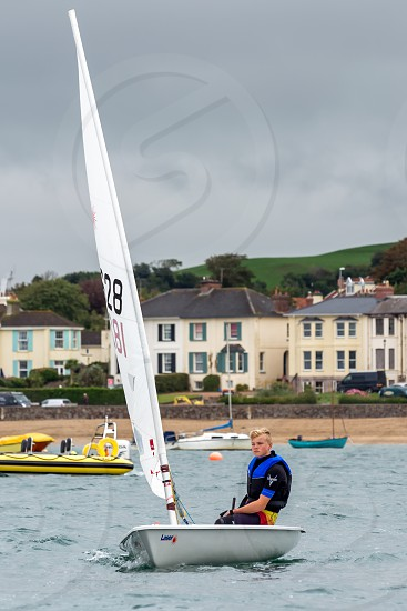 Young man sailing in the Torridge and Taw Estuary in  Devon photo