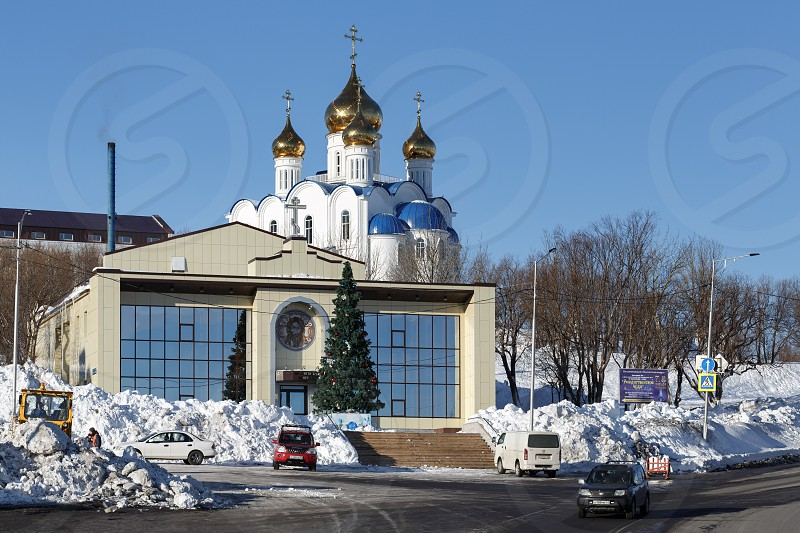 PETROPAVLOVSK CITY KAMCHATKA RUSSIA - JANUARY 6 2018: Diocesan Spiritual and Enlightenment Center and Holy Trinity Orthodox Cathedral of Petropavlovsk Kamchatka Diocese of Russian Orthodox Church. photo