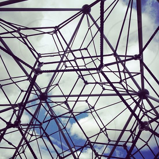 Playground spiderweb net sky play structure park photo