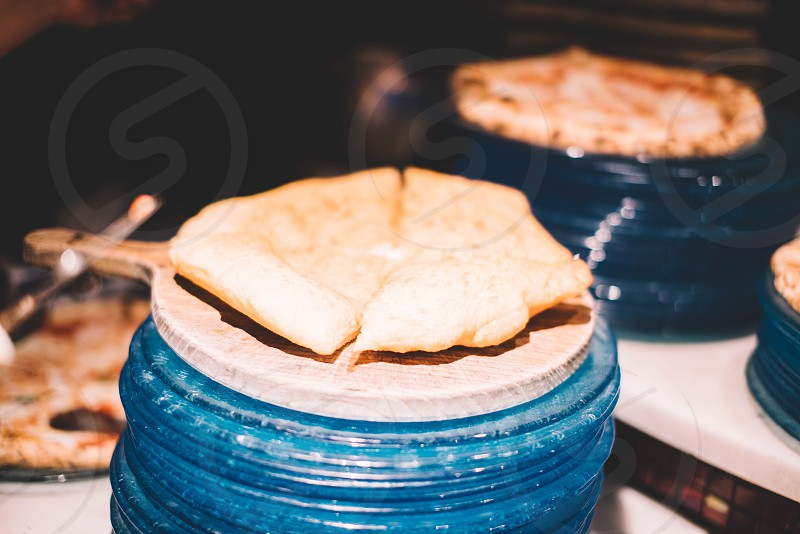 pancake above blue and brown round container in closeup photography photo