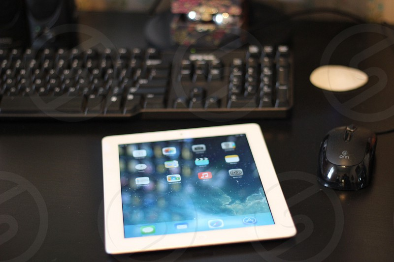 white ipad near mouse and keyboard photo