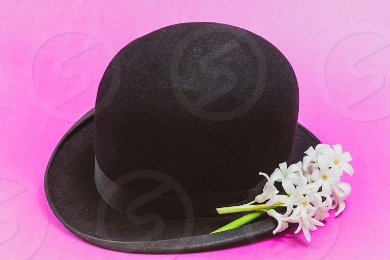 Anitque Bowler Style Hat with White Hyacinth Flowers photo