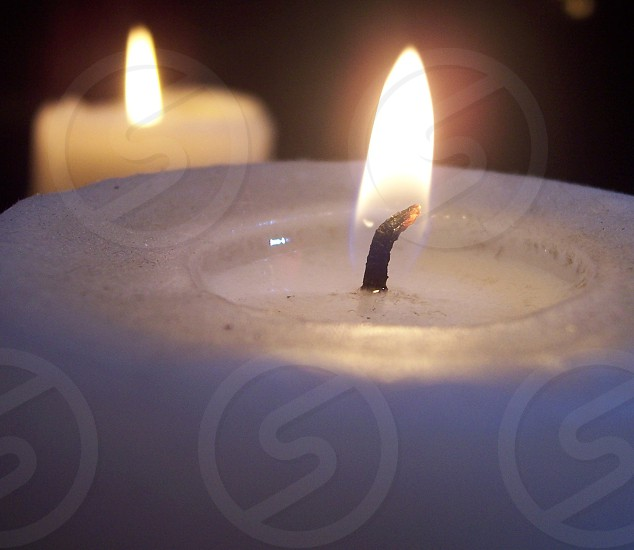white pillar candle with light photo